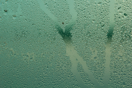 Steam on glass caused by moisture and background. Stock Photo
