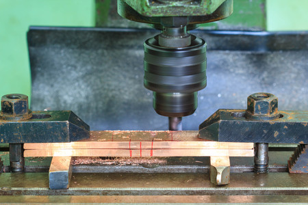 milling press drilling a copper plate. A fast shutter was used. Focus is on the point where the milling edge plate.