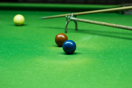 Player was shooting ball on snooker table