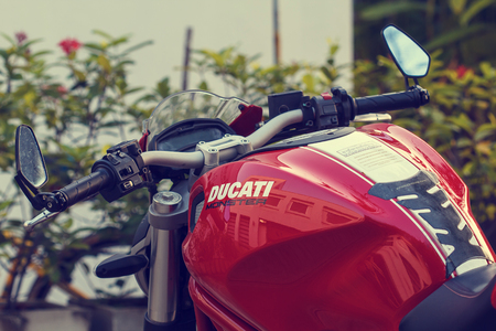 Bangkok - Thailand DECEMBER-16 th, 2016: Red motorcycle Ducati Monster 796 at the city street.