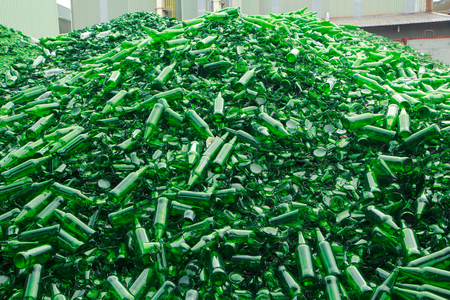 background many recycle pieces of broken glass in green