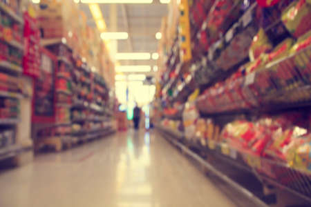 Blurred image of supermarket shopping - product shelf - business concept