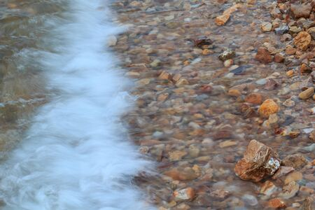 Stone in sea with wave background