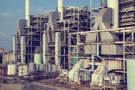 Smokestack in power plant and storage tank Banco de Imagens