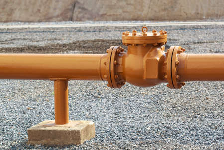 Pipe and valve  oil brown leg support  flowing