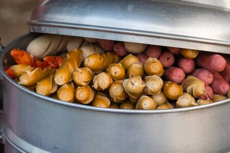 Meat balls and sausages. Thai snack, meat balls and sausages are steaming on steel tray.