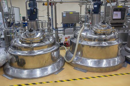 shiny stainless steel pipes, tanks for the cream cosmetic  industry 写真素材