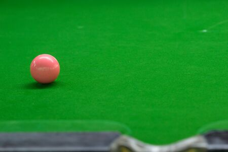 pink Ball and Snooker Player green carpet floor