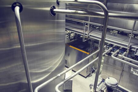 Modern milk cellar with stainless steel tanks and pipeline