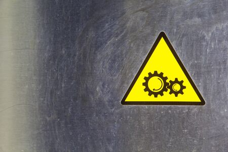 Warning pin gear symbol background stainless