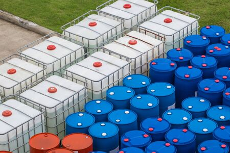 Oil barrels blue and white or chemical drums stacked up