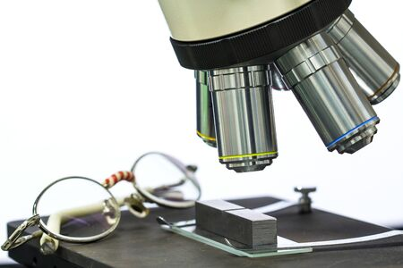 Focus objective Lens  and glasses of microscope on the isolate white background