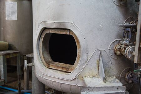 opened rusty manhole on the white fuel tank vessel confined space 版權商用圖片