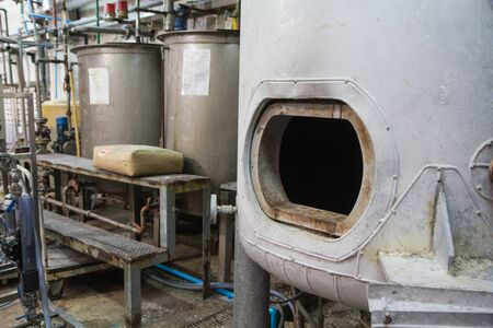 opened rusty manhole on the white fuel tank vessel confined space Standard-Bild