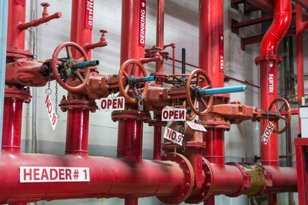close-up of the valve open plug an gas and oil red pipeline Standard-Bild
