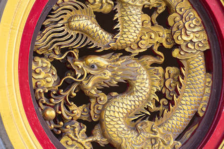 Dragon gold wood window at temple Thailand