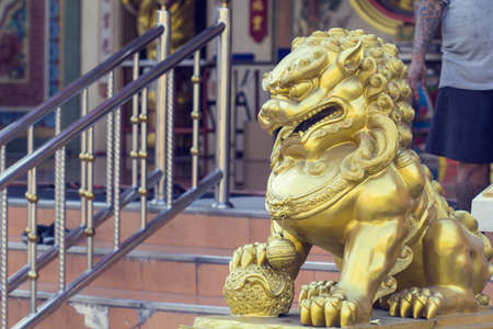 Steel lion gold on the spectacular temple in Thailand. Editorial