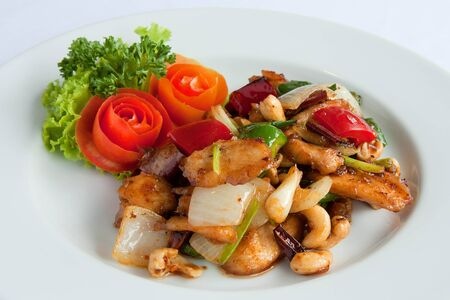 Thai food,stir fired chicken with cashew nuts a famous thai dish. photo