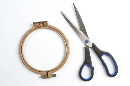stitchery: And pulling for embroidery and fabric scissors. Stock Photo