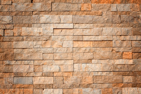 Background of stone wall made with blocks photo