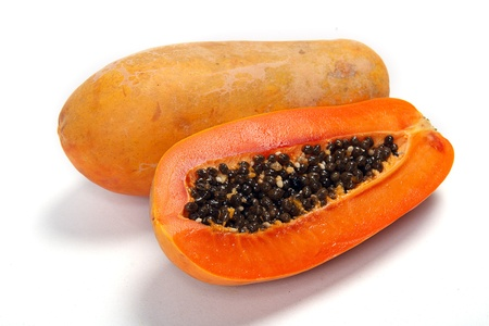 produce sections: Cut papaya showing the seeds within Stock Photo