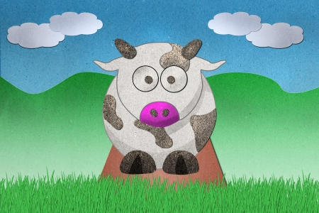 Dairy cows recycled paper craft on paper background Stock Photo - 11062550