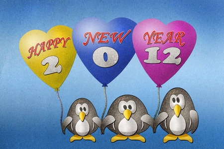 Penguins happy new year 2012 recycled paper craft on paper background photo