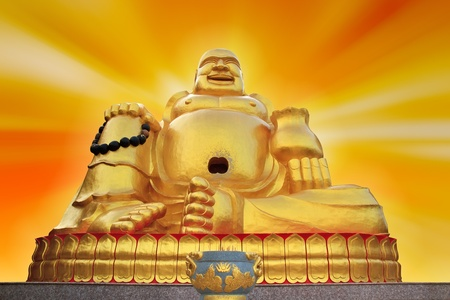 praye: buddha statue  in chinese temple on a gold background.