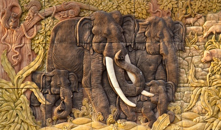 Elephant carved temple door in the countries of Thailand photo