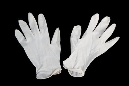 surgical tool: Medical gloves on black background