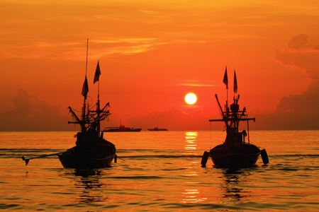 Fishing boat sunrise, huahin thailand photo