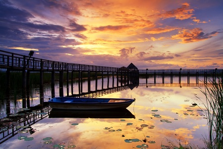 Boat and wooden bridge with a beautiful sky. photo