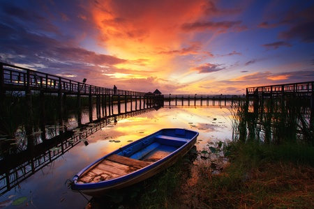 Boat and wooden bridge with a beautiful sky.