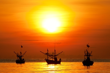 fishing boat: Fishing boat sunrise Stock Photo