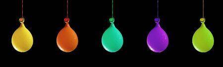 A row of colorful party balloons on black background, add copy space Stock Photo - 11718726