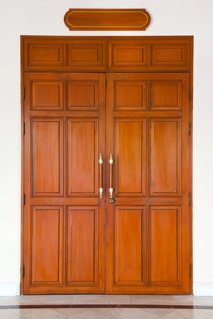 front door: Curving wooden door Stock Photo