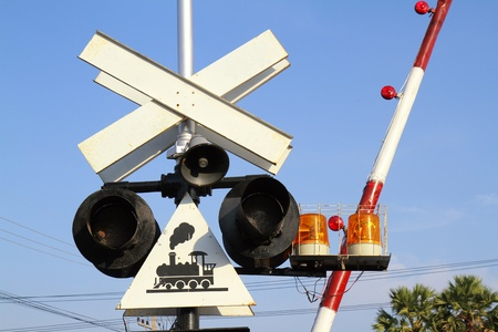 guard rail: Guard rail and warning lights at railroad crossing