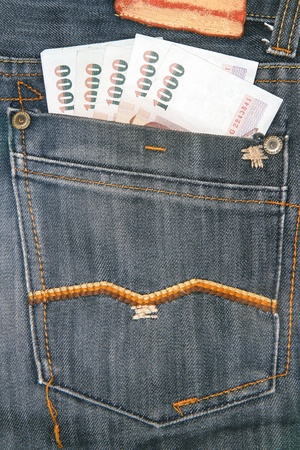 Bank of Thailand in blue jeans back pocket photo