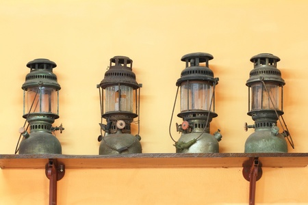 Old dusty oil lamp photo