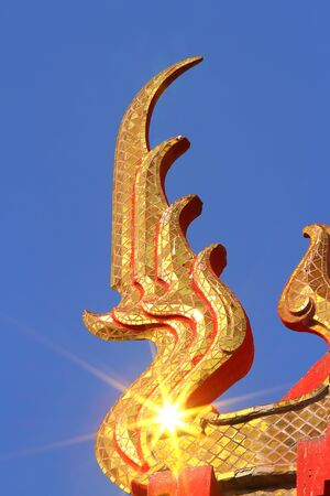 gabled: detail of ornately decorated temple roof in huahin, thailand