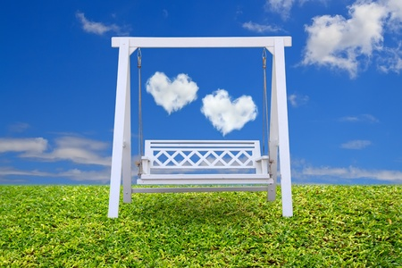 Wood swing chair with beautiful cloud and sky photo
