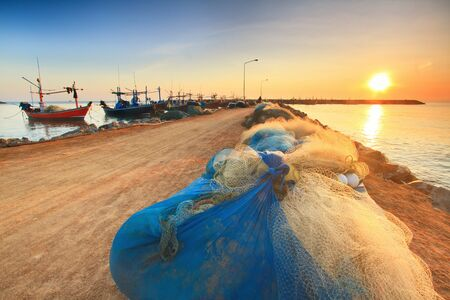Fishing nets on the waterfront after fishing day. photo