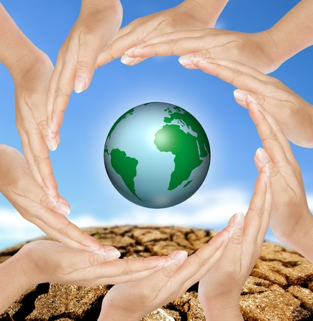 Earth in circle hands, concept of saving energy photo