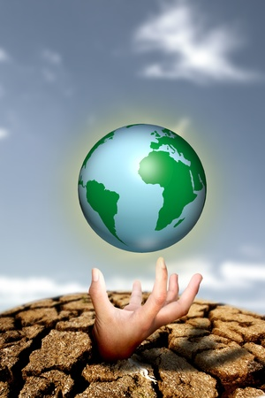 earth on hand, concept of saving energy photo