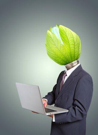Businessman , Green light bulb head holding a notebook computer. Stock Photo - 12162635