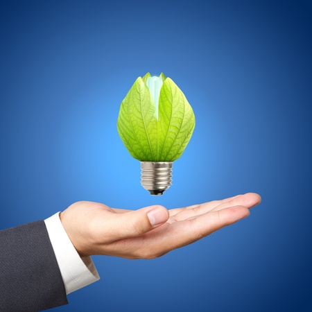 Concept of energy saving light bulbs on Business hand photo