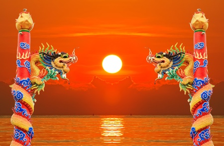 Chinese golden dragon with sunrise  background photo