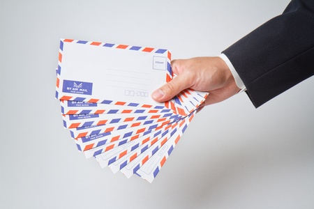 Businessman holding  envelope photo