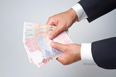Businessman counts money in hands. photo