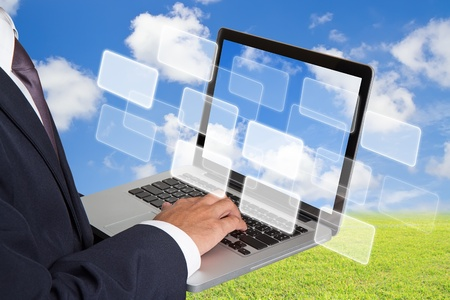 businessman working with laptop and virtual buttons